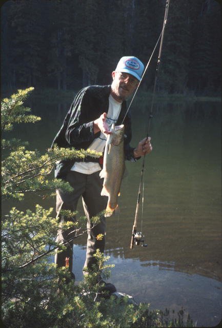 and sometimes with dramatic fish.  This is a picture of John Thomas with a high lake rainbow that weighed about 4-5 pounds.