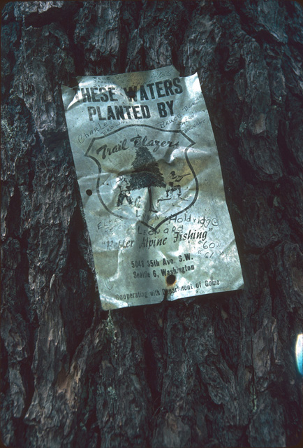 Here is an old Trail Blazer sign on a tree in the wilderness, a rare artifact that is now hard to find, although lakes planted by the Trail Blazers club are common.