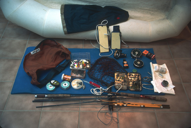 Here is a set of gear that I often took into the mountains for day trips and overnights.  All of the gear in the picture, except for the raft and paddles, foam pad, and fishing rods, could fit into the orange fanny pack.  The raft is a single person, light-weight raft weighing only 22 ounces.  I usually took both 4-piece fly rod and spinning rod with reels for each, in case I broke one rod scrambling off-trail.  That way I would at least have a rod for fishing the rest of the trip.