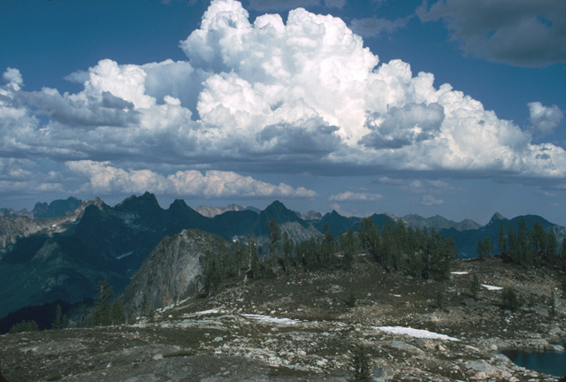 The weather can sometimes be as dramatic as the surrounding peaks.  Here gathering thunderclouds catch the afternoon sunlight in the north Cascades.
