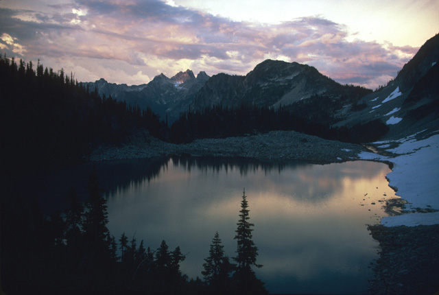 Or the clouds may provide a sunset pallette of colors reflected in the quiet waters of an alpine lake.