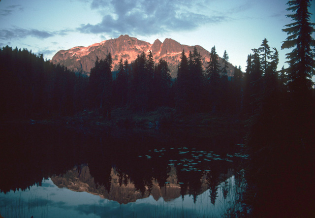 And the peaks can catch the last rays of sunshine and mirror their high splendor in the glassy waters by your camp.