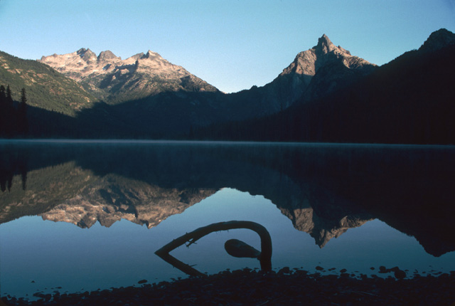 This is a morning sunrise view of Summit Chief (left) and Bears Breast (right) seen from the outlet end of Waptus Lake.