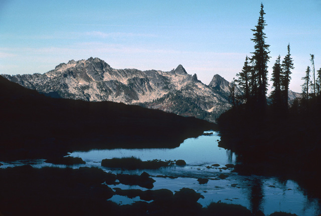 This is a morning view of the Bulls Tooth, from the outlet of lower Grace Lake on the western flank of the Chiwaukum mountains.