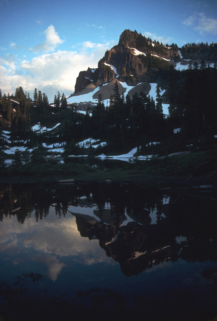 House Mountain (? House Rock?) reflected in American Lake south of White Pass.