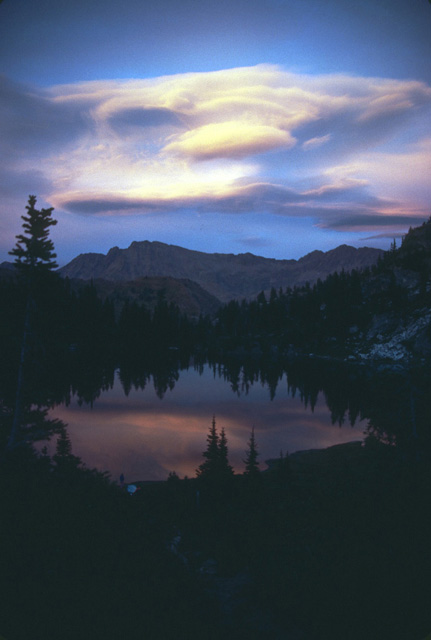 Sunset colors on lenticular clouds above the Chiwaukum Mountains as viewed from Upper Doelle Lake.