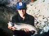 This is an example of a four pound, 20 inch Mt. Whitney rainbow (female) held by John Thomas.