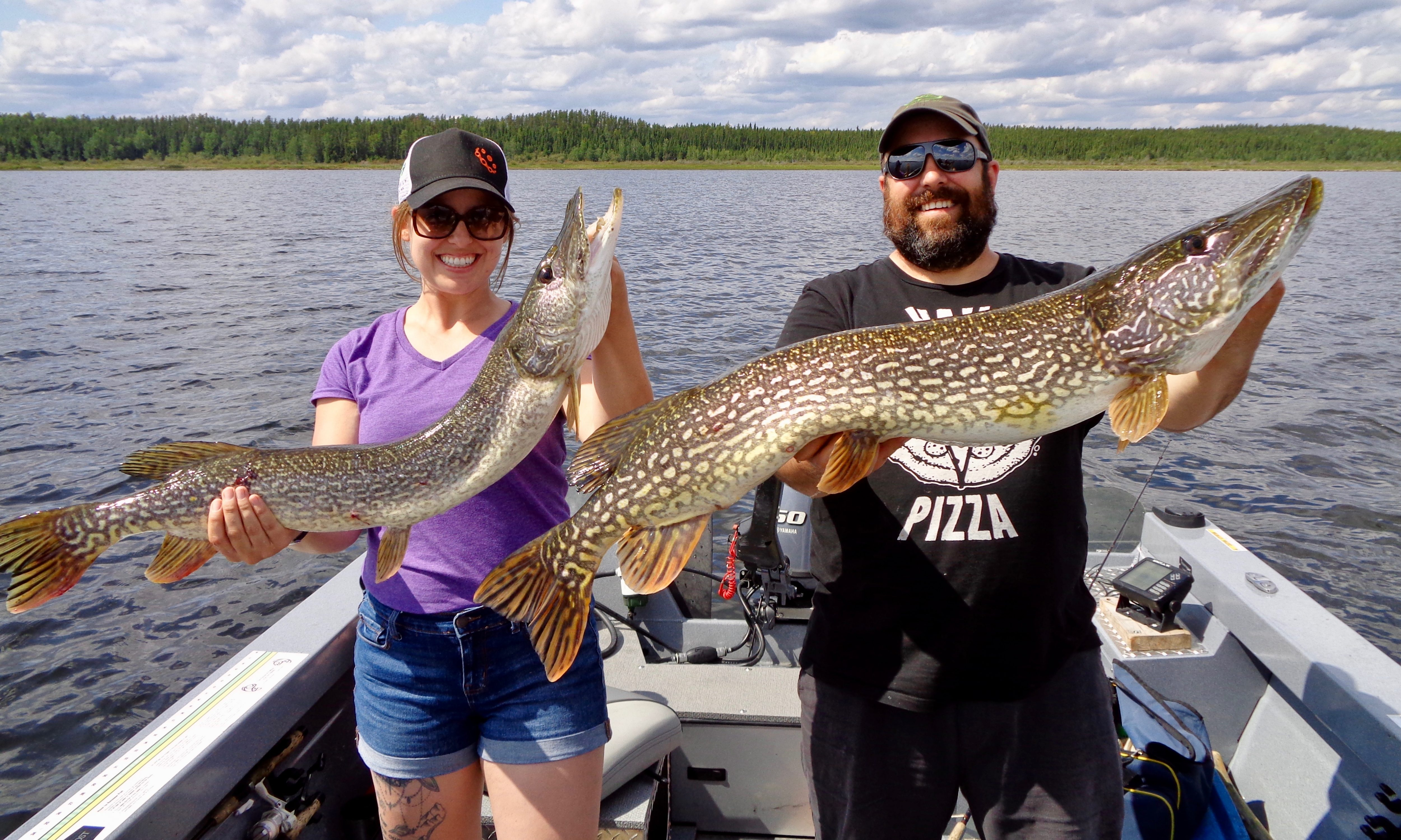 Andy and Ashley McGuire with trophy pike at Lake St Joseph
